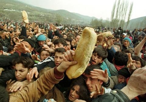 Image result for men fighting over food